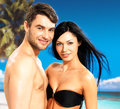 Happy beautiful couple in love at tropical beach portrait of smiling Stock Image