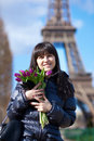 Happy beautiful girl with tulips in Paris Royalty Free Stock Images