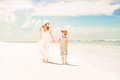 Happy beautiful mother and son enjoying beach time Royalty Free Stock Photo