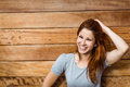 Happy beautiful redhead touching her hair in the city Royalty Free Stock Photos