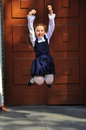 Happy and beautiful school girl  jumping outdoor Royalty Free Stock Photo