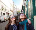 Happy beautiful student girls in paris street on the Stock Image