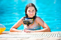 Happy beautiful teen girl smiling at the pool Royalty Free Stock Photography