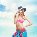 Happy beautiful woman in bikini at beach and hat the smiling Stock Image