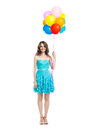 Happy beautiful woman in blue dress holding colorful balloons Royalty Free Stock Photo