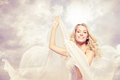 Happy beautiful woman carefree dancing with flying fabric blonde Royalty Free Stock Images