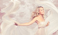 Happy beautiful woman carefree dancing with flying fabric blonde Stock Photography