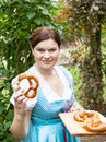 Happy beautiful woman in dirndl dress holding pretzel girl oktoberfest hands Stock Photography