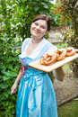 Happy beautiful woman in dirndl dress holding pretzel girl oktoberfest hands Royalty Free Stock Image