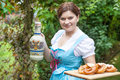 Happy beautiful woman in dirndl dress holding pretzel young girl oktoberfest and beer mug hands Stock Photos