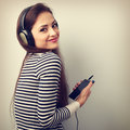 Happy beautiful woman holding player and listening music in head Royalty Free Stock Photo