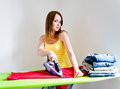Happy beautiful woman ironing clothes young housework Stock Images