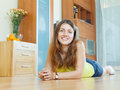 Happy beautiful woman on parquet floor having rest at home interior Royalty Free Stock Photo
