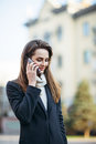 Beautiful woman speaking on mobile phone on the city street Royalty Free Stock Photo