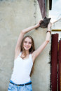 Happy beautiful woman with street cat Royalty Free Stock Photo