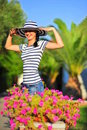 Happy beautiful woman wearing sun hat Royalty Free Stock Image