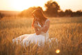 Happy beautiful young bride outside on a summer meadow at the sunset Royalty Free Stock Photo