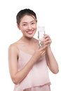 Happy beautiful young vietnamese woman drinking water. Royalty Free Stock Photo