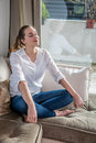 Happy beautiful young woman relaxing in yoga lotus position