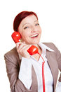 Happy best ager business woman on a red phone receiver Royalty Free Stock Images