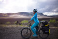 Happy biker on backdrop of volcanic mountains in Iceland