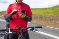 Happy biker using his phone on road in Iceland