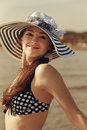 Happy bikini woman on beach in hat background vintage closeup portrait Stock Image