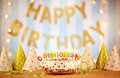 Happy birthday cake with candles Russian letters on the backgrou Royalty Free Stock Photo