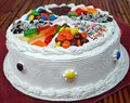 Happy birthday cake a traditional decorated with assorted candy Stock Images