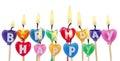 Happy birthday candles burning colorful isolated on white background Stock Photos
