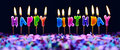 Happy birthday candles and party confetti isolated Royalty Free Stock Photo
