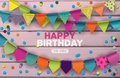 Happy Birthday card with colorful paper garlands and confetti