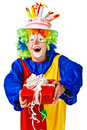 Happy birthday clown with gift box. Royalty Free Stock Images