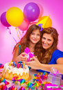 Happy birthday of daughter beautiful mother congratulate her little girl festive cake with candles colorful decorations happiness Royalty Free Stock Photography