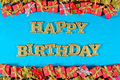 Happy birthday golden text and golden and red gifts on a blue Royalty Free Stock Photo
