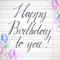 Happy birthday inscription in hand writing on copybook page with watercolor flowers on sides. Square shape greeting card