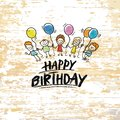Happy birthday with kids on wooden background