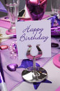 Happy birthday party table pink and purple theme setting decorations with message vertical Stock Photos