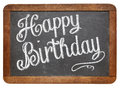 Happy birthday on slate blackboard greetings white chalk text a vintage isolated white Stock Image