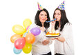 Happy birthday woman of younger women celebrate with her friend and blow out horn party together Royalty Free Stock Photo
