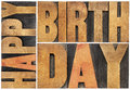 Happy birthday in wood type isolated text abstract letterpress printing blocks scaled to a rectangle Stock Images