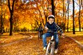 Happy black brothers ride in park smiling years old boy riding a bike the autumn with his brother Stock Photo