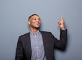Happy black business man pointing finger Royalty Free Stock Photo
