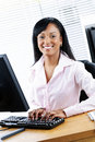 Happy black businesswoman at desk Royalty Free Stock Photo