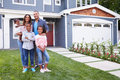Happy black family standing outside their house Royalty Free Stock Photo