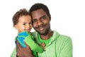 Happy black father and  baby boy cuddling on isolated white background  Use it for a child, parenting or love Royalty Free Stock Photo