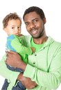 Happy black father and baby boy cuddling on isolated white background Royalty Free Stock Photo