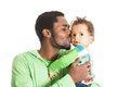 Happy black father and baby boy cuddling on isolated white use it for a child parenting or love concept Stock Photo