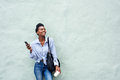 Happy black woman holding mobile phone Royalty Free Stock Photo