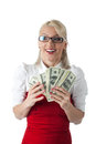 Happy blond business woman in red with money Royalty Free Stock Image